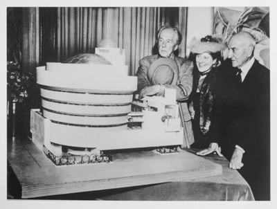 Frank Lloyd Wright, Hilla Rebay and Solomon R. Guggenheim, during unveiling of the model for the Museum of Non-Objective Art